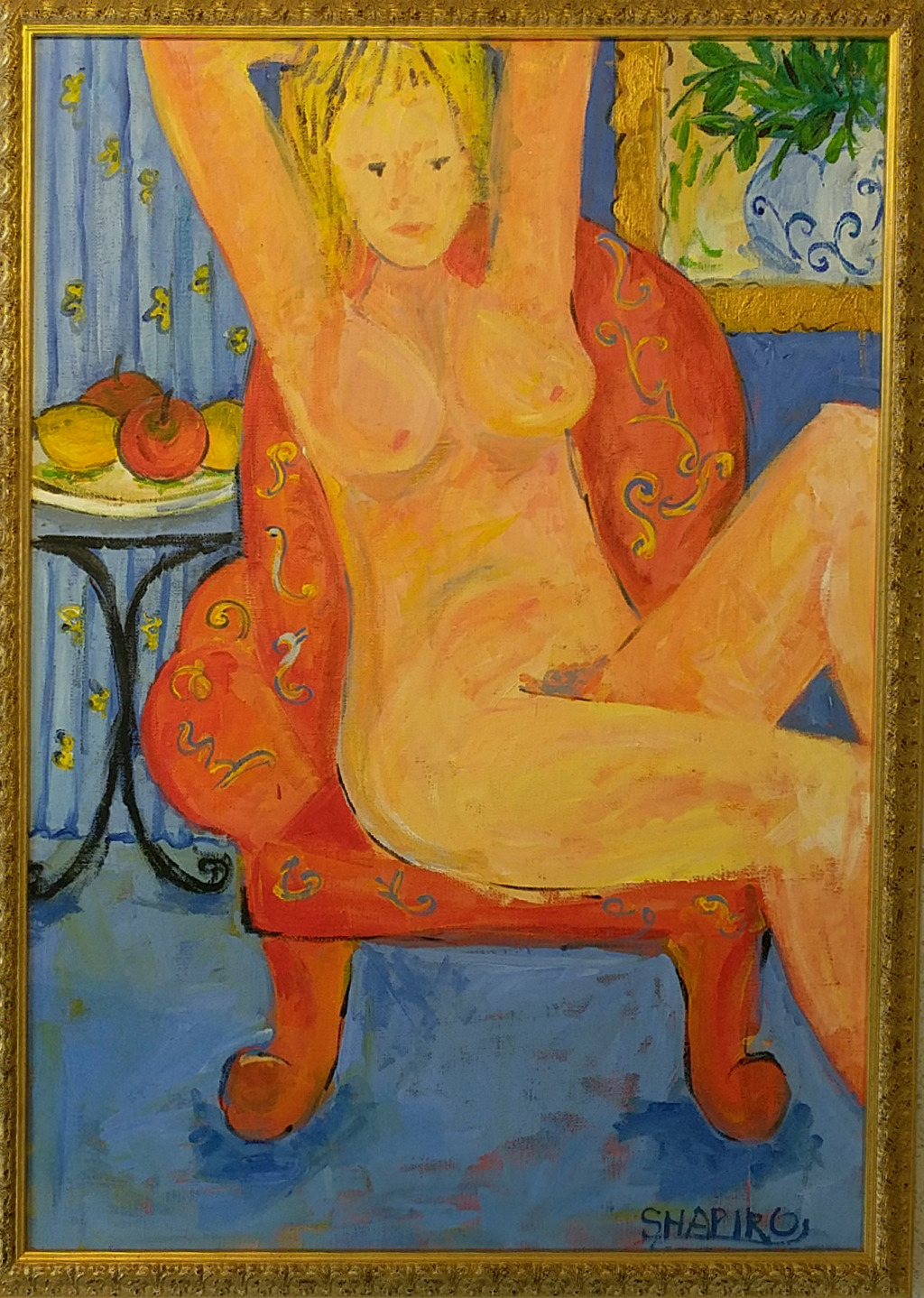 6. Lady on a red armchair
